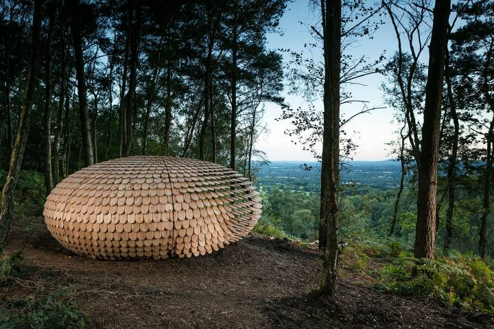 Wooden sculpture in a forest landscape