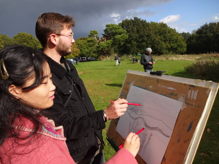 Couple drawing at Newlands Corner